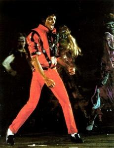 I love all of his outfits,but my favoriete MJ outfit is definetly the outfit he wore in Thriller.i just love how he looks in red!