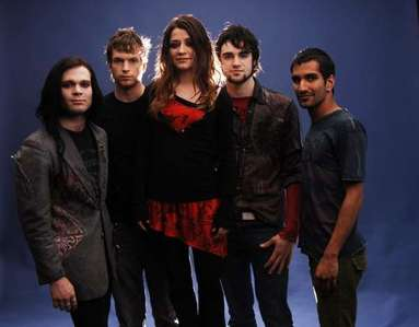 Flyeaf! Hands down. They're one of the best bands out there, and Justin is just not talented at all, IMO. Flyleaf rocks!! :D