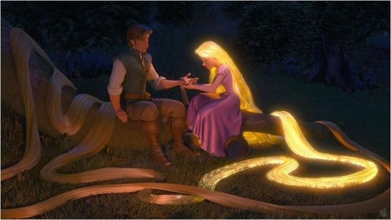 Rapunzel showing him the power of her hair and healing him.