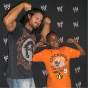 "John Morrison posing with Favaughn, his first ""wish kid."""