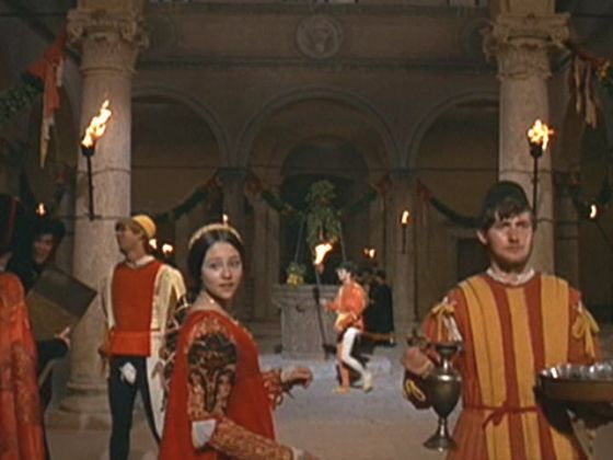 Photo #9 Juliet gets dizzy from going round and round in a circle with people in the Moresca Dance & runs out of the circle in the 1968 Romeo & Juliet film.