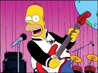 Homer rocks out in 'How I spent my strummer vacation'