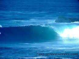 The waves were a beautiful blue; the sand was warming my back.