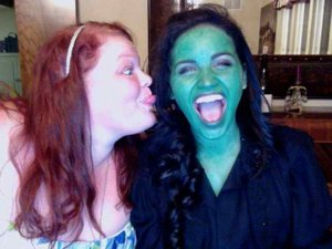 Hannah and Lindsay after a benifit concert where Lindsay sang Defying Gravity from wicked. (Hence why she is green)