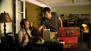 Steve McGarrett listens to a recording that was left in his father's red toolbox before he was murdered.