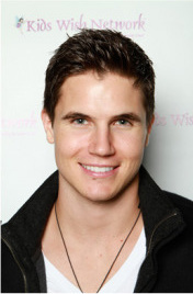 Robbie Amell at Kids Wish Network's Holiday of Hope party at WMMC.