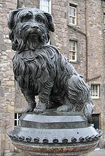This statue of Bobby sits at the corner of Edinburgh's Candlemaker Row and George IV Bridge, and is a Category A listed building