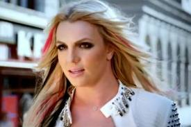 "Britney Spears' video for ""I Wanna Go"" — a dream-sequence-y, pop-culture-reference-packed tongue-i"