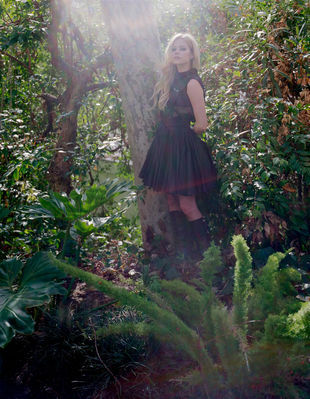 Avril in a beautiful green garden :) A pic of Avril with an animal that is not a dog অথবা cat... if th