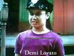 lol Demi in a BLACK dress haha that's gonna be hard to find. ;)