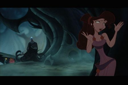Find a picture of Belle and The Beast in winter clothes