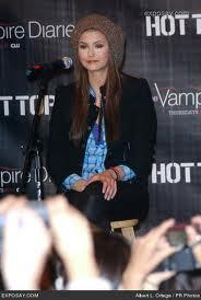 19: Nina wearing a blue dress.