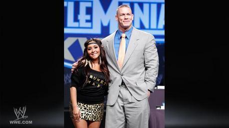 Next:John Cena wearing headphone