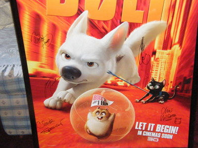 So I got this rare bolt poster and the neat part is its personally sighned par John Travolta Miley Cyr