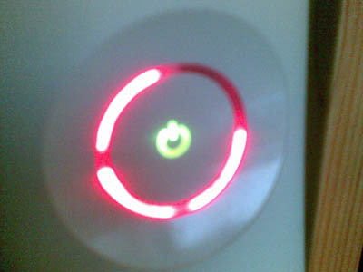 I was playing my Xbox 360, shootin' zombies in Left 4 Dead until THE RED RINGS OF DEATH APPEARED! D: