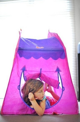 Renesmee playing in pop up tent