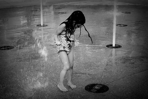 Renesmee playing in the sprinklers