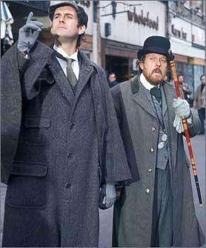 John Cleese as Sherlock Holmes