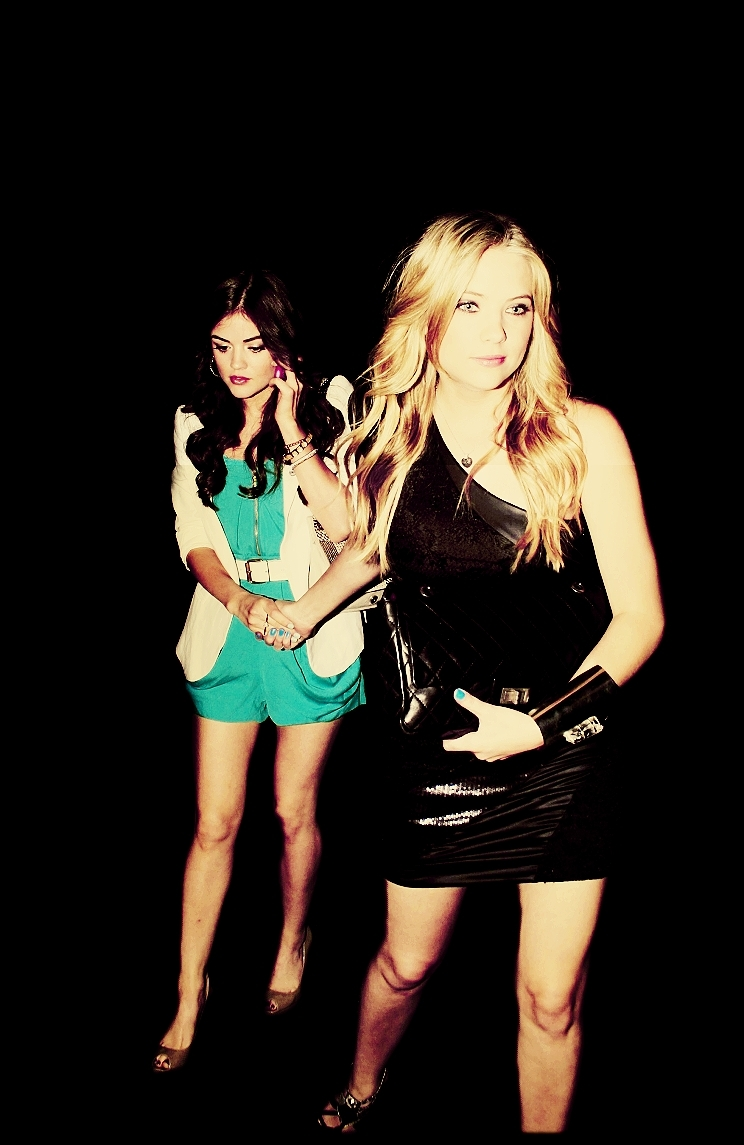 Lucy and Ashley holding hands.