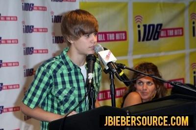 WNFN presents a check to Justin