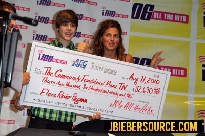 WNFN presents a check to Justin