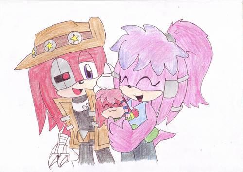 Knuckles and Julie-Su holding Lara-Su