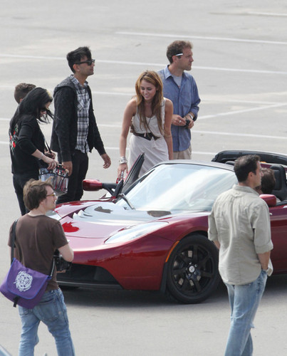 Miley Cyrus achtergrond called Miley Cyrus Photoshoot in a Tesla Roadster