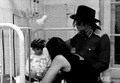 Mj & Lisa helping the children - michael-jackson photo