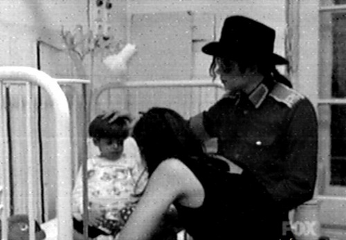 Mj & Lisa helping the children