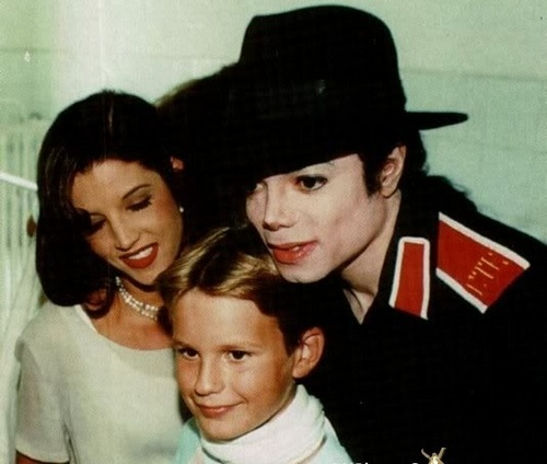 Mj & Lisa helping the children