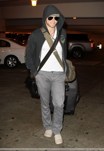 Kellan Lutz wallpaper probably with sunglasses and a machete called  LAX Airport - 29 August 2010