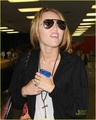 Miley Cyrus arriving at JFK Airport (August 30).