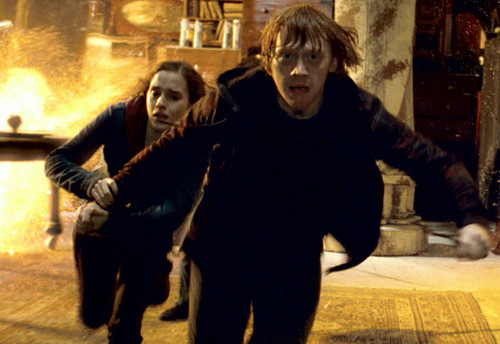 Ron and Hermione running in the Room of Requirement.
