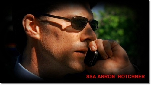 SSA Aaron Hotchner achtergrond probably containing sunglasses and a business suit entitled SSA Aaron Hotchner