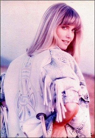 Olivia Newton-John wallpaper possibly containing a pullover and a portrait titled Olivia