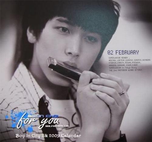 Sungmin playing harmonica