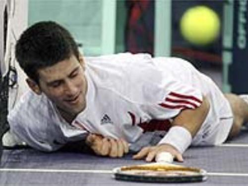 Novak Djokovic پیپر وال probably with a tennis pro and a tennis player titled ball