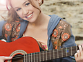 miley play on guitar - miley-cyrus-vs-selena-gomez wallpaper