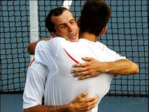 Novak Djokovic wallpaper with a tennis player and a tennis pro called stepanek djokovic embrace 2 * * * * *