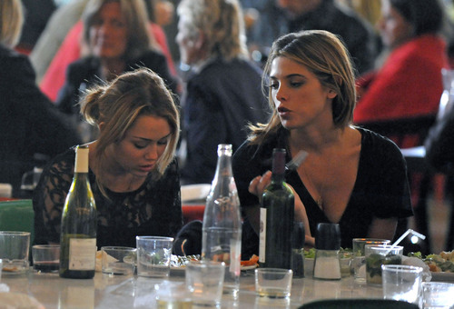 Ashley and Miley wine & dine in Paris