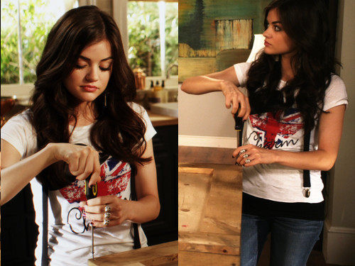Aria Montgomery wallpaper possibly with a sign titled Aria