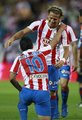 Diego Forlan wins with Atlético Madrid against Sporting Gijon
