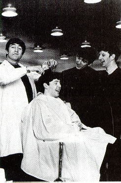 "John giving Paul a ""haircut"""