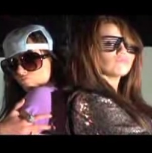 Miley Cyrus vs. Selena Gomez kertas dinding containing sunglasses called it's cool.
