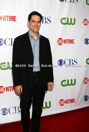 Thomas Gibson wallpaper with a business suit and a well dressed person entitled CBS stars party