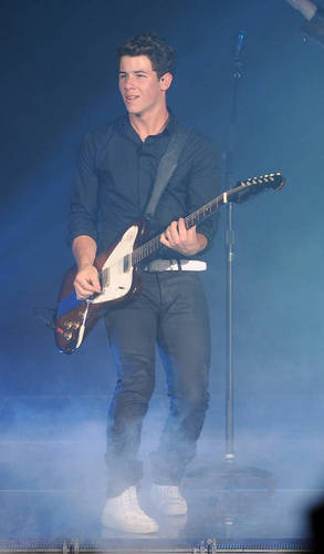 Nick Jonas wallpaper containing a guitarist titled Florida 9/7