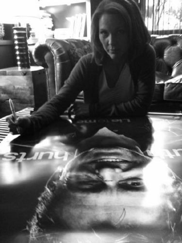 Kelli Signing a Poster