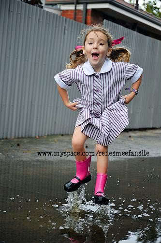 Renesmee jumping in the puddles