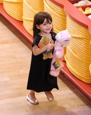 Renesmee picking out teddys