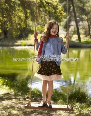 Renesmee playing on her swing
